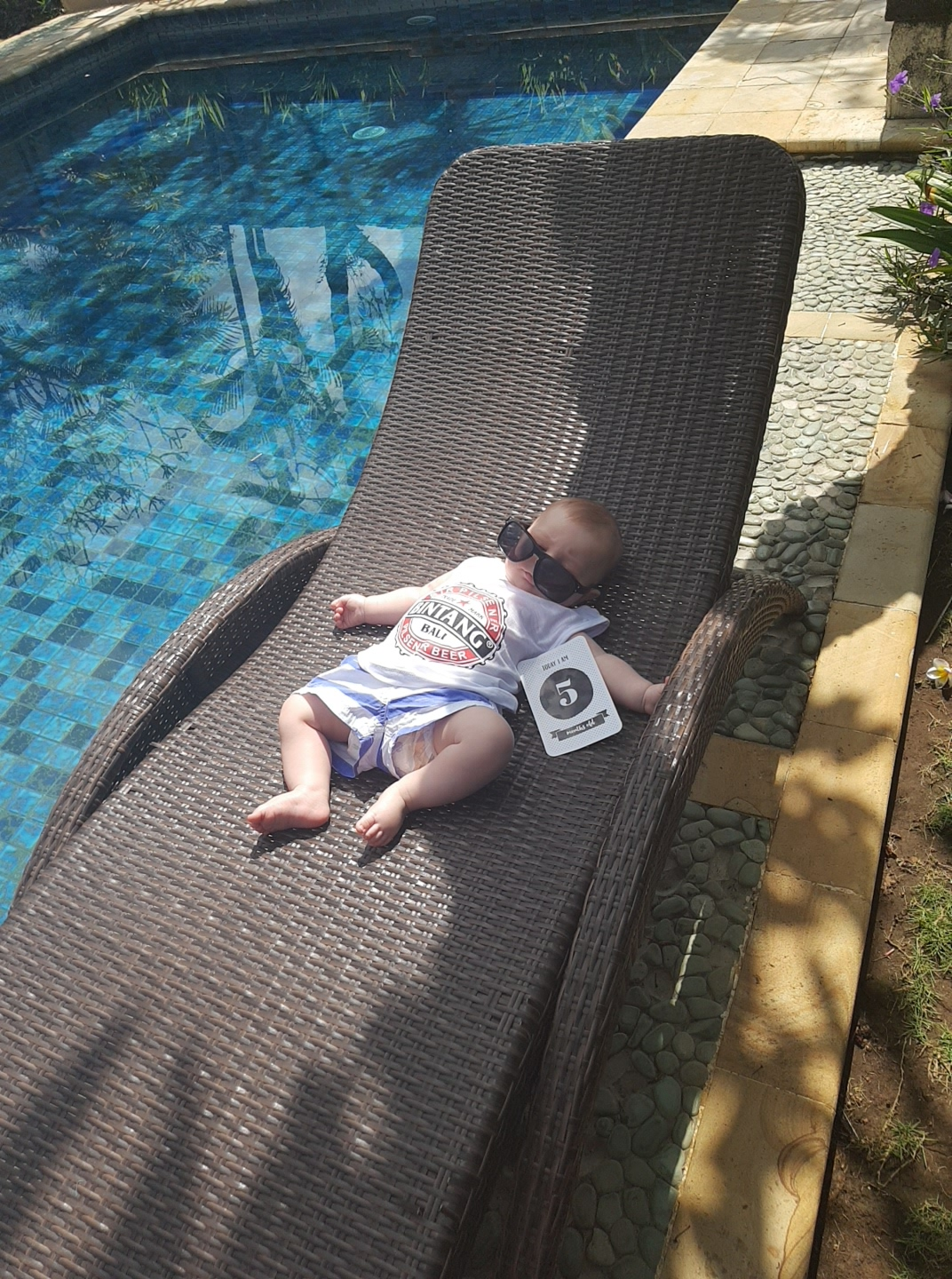 IMAGE 5 months today - it's hard work sinking milk bottles by the pool all day